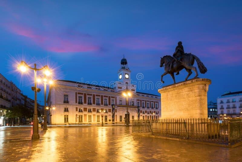 Madrid cityscape at night. Landscape of Puerta del Sol square Km stock photos