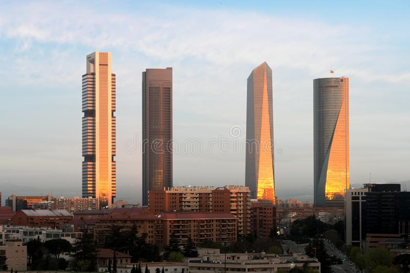 Madrid Four Towers financial district skyline during sunrise in royalty free stock photos