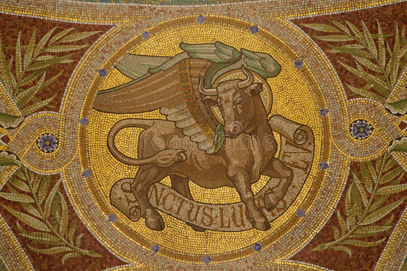 Madrid - Mosaic of bull as symbol of Saint Luke the Evangelist in Iglesia de San Manuel y San Benito. By architect Fernando Arbos from 19. cent. in March 9 royalty free stock photography