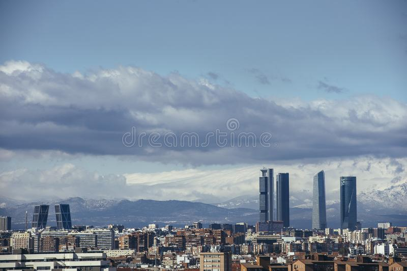 Madrid Skyline from the air, snowy in the background mountains royalty free stock photo