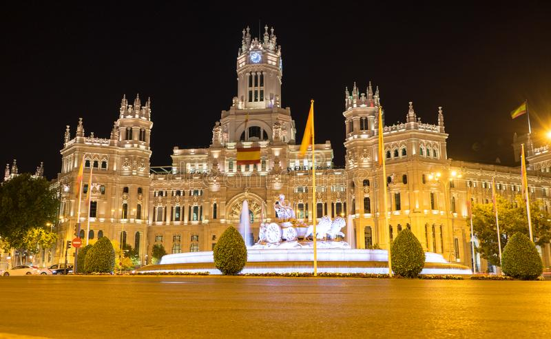 Madrid / Spain - 02 August 2019: Night sight in the famous spot of the sculpture Cibeles, iluminated and the post office in the. Metropolis and the light royalty free stock photography