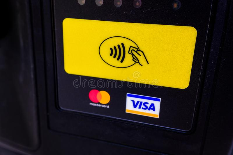 Madrid, Spain - August 28, 2019: Visa and MasterCard logos in a contactless reader to pay by credit card stock image