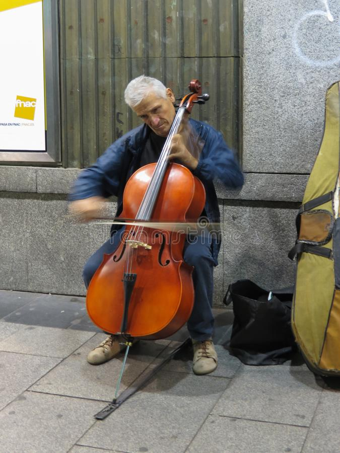 Unidentified cello player in Madrid royalty free stock photo