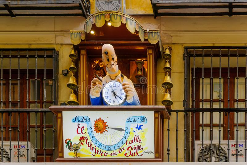 Figure of a clockmaker, in Madrid. MADRID, SPAIN - DECEMBER 31, 2017: Figure of a clockmaker, marking an historical clock shop, in Madrid, Spain stock images