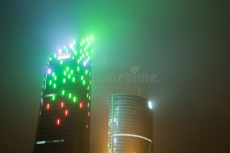 Madrid, Spain - December 25, 2017: skyscraper at night with haze. And lighting style blade runner stock images