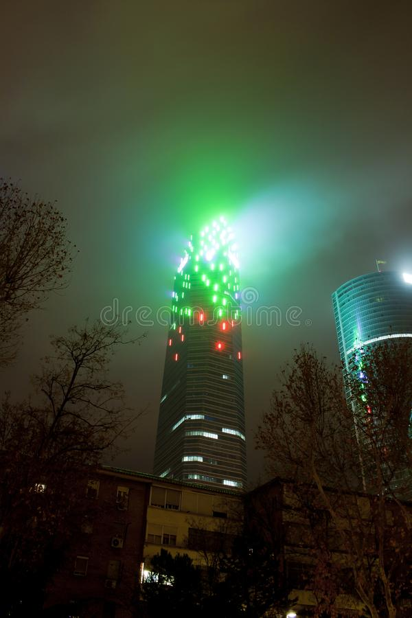 Madrid, Spain - December 25, 2017: skyscraper at night with haze. And lighting style blade runner stock photo