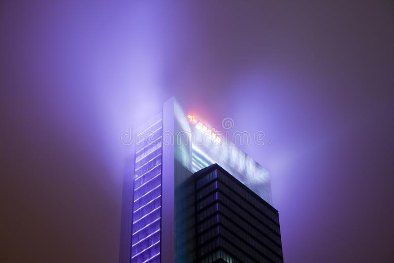 Madrid, Spain - December 25, 2017: skyscraper at night with haze. And lighting style blade runner royalty free stock image