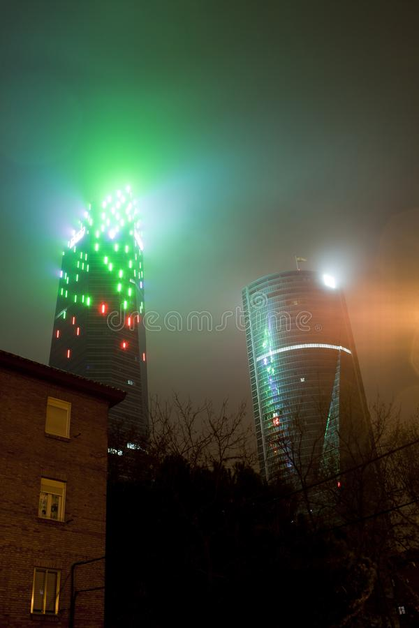 Madrid, Spain - December 25, 2017: skyscraper at night with haze. And lighting style blade runner stock photography