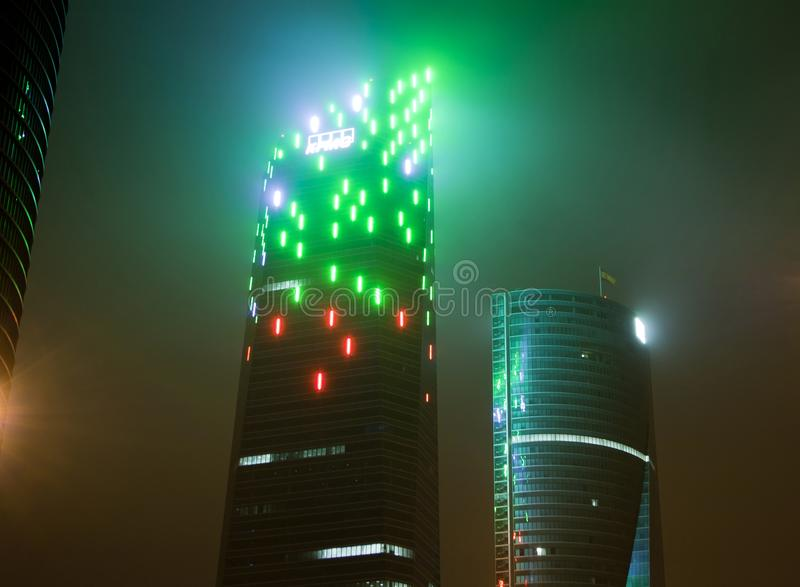 Madrid, Spain - December 25, 2017: skyscraper at night with haze. And lighting style blade runner stock image