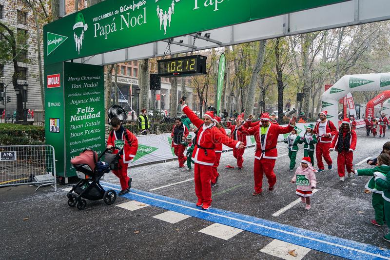 Madrid, Spain, December 8th 2019: Crowd of Santa Clauses running in street royalty free stock photography