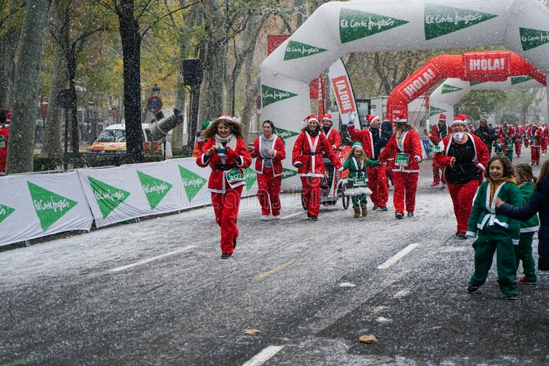 Madrid, Spain, December 8th 2019: Crowd of Santa Clauses running in street royalty free stock photos