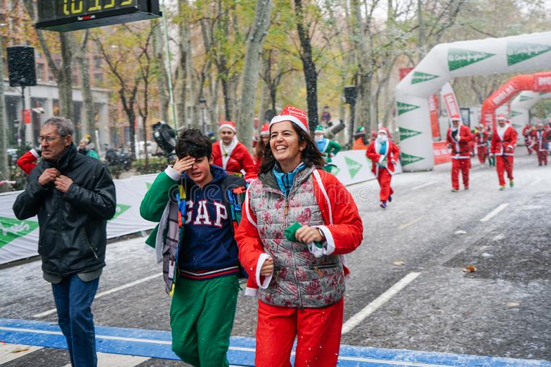 Madrid, Spain, December 8th 2019: Crowd of Santa Clauses running in street royalty free stock photo