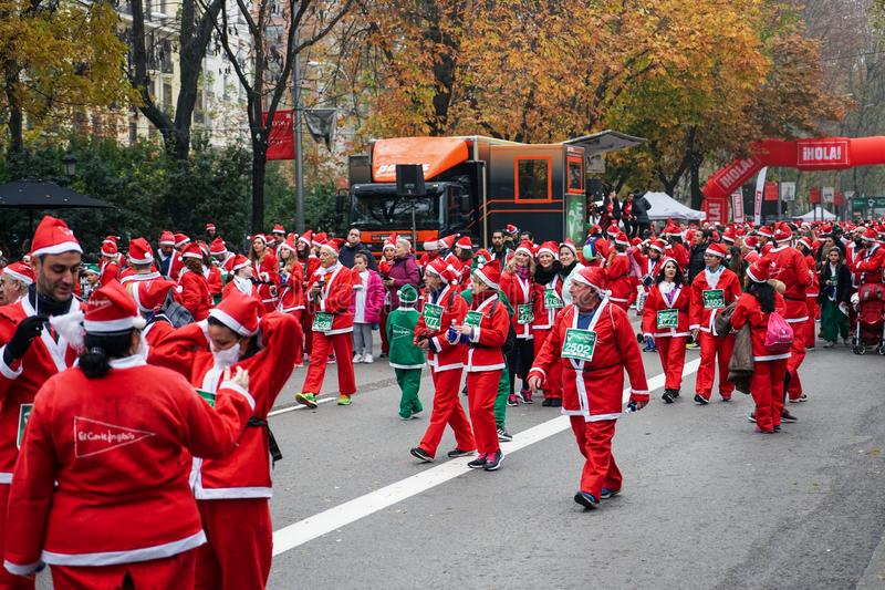 Madrid, Spain, December 8th 2019: Crowd of Santa Clauses running in street stock images