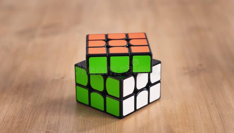 Madrid, Spain; 06 february 2019: Rubik Cube puzzle intelligence toy game solved, three sides stock image