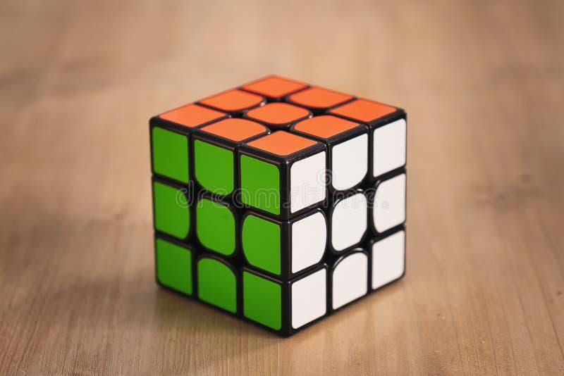 Madrid, Spain; 06 february 2019: Rubik Cube puzzle intelligence toy game solved, three sides stock photo