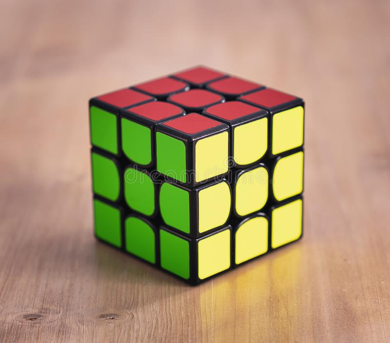 Madrid, Spain; 06 february 2019: Rubik Cube puzzle intelligence toy game solved, three sides royalty free stock photos