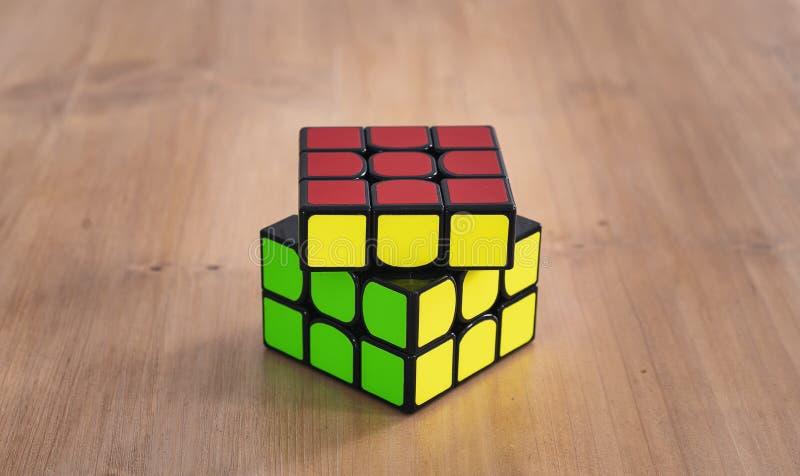 Madrid, Spain; 06 february 2019: Rubik Cube puzzle intelligence toy game solved, three sides stock photography