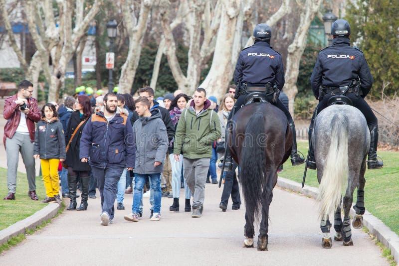Spanish mounted police officer in Madrid, behind `Plaza de España`. Madrid, Spain, February 12, 2018: Spanish mounted police officer in Madrid, behind `Plaza royalty free stock photo