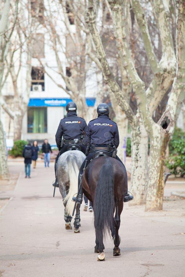 Spanish mounted police officer in Madrid, behind `Plaza de España`. Madrid, Spain, February 12, 2018: Spanish mounted police officer in Madrid, behind `Plaza stock image