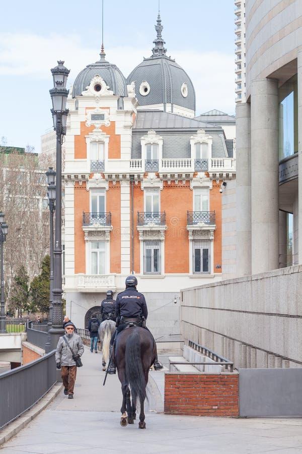 Spanish mounted police officer in Madrid, behind `Senado` Senate. Madrid, Spain, February 12, 2018: Spanish mounted police officer in Madrid, behind `Senado` royalty free stock images