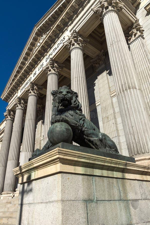 Lion sculpture in front of Building of Congress of Deputies Congreso de los Diputados in City. MADRID, SPAIN - JANUARY 22, 2018: Lion sculpture in front of stock images
