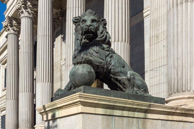 Lion sculpture in front of Building of Congress of Deputies Congreso de los Diputados in City. MADRID, SPAIN - JANUARY 22, 2018: Lion sculpture in front of stock photos