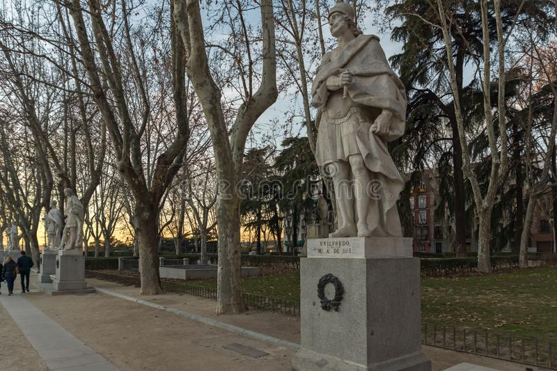 Sunset view of Gardens of Cape Noval and Royal Palace in City of Madrid, Spain. MADRID, SPAIN - JANUARY 22, 2018: Sunset view of Gardens of Cape Noval and Royal stock photo