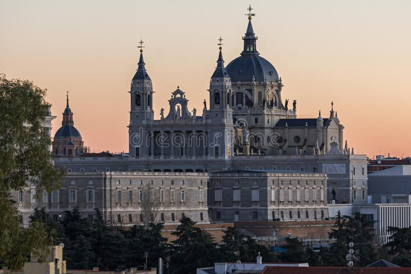 Sunset view of Royal Palace and Almudena Cathedral in City of Madrid, Spain. MADRID, SPAIN - JANUARY 21, 2018: Sunset view of Royal Palace and Almudena Cathedral stock photo