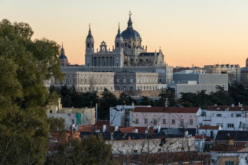 Sunset view of Royal Palace and Almudena Cathedral in City of Madrid, Spain. MADRID, SPAIN - JANUARY 21, 2018: Sunset view of Royal Palace and Almudena Cathedral stock photography