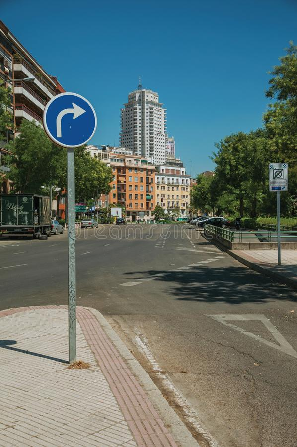 Street with KEEP RIGHT signpost and building in Madrid royalty free stock images