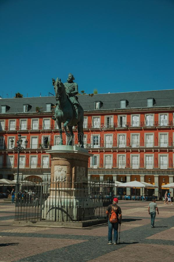 People on the Plaza Mayor with the statue of King Philip III in Madrid. Madrid, Spain - July 24, 2018. People on the Plaza Mayor with the bronze equestrian stock photography