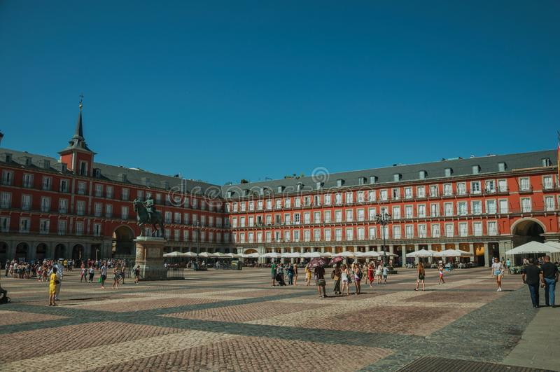 People on the Plaza Mayor with old large building in Madrid royalty free stock images