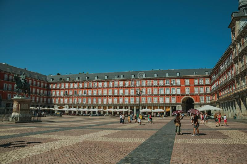 People on the Plaza Mayor with old large building in Madrid royalty free stock photography