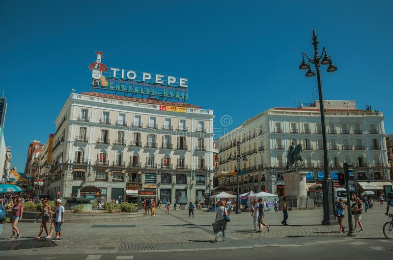 People at the Puerta del Sol Square with buildings in Madrid royalty free stock images