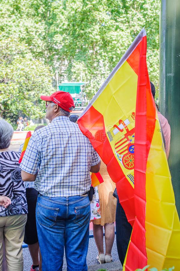 Celebration of the coronation of the New King of Spain Felipe IV. MADRID, SPAIN - JUN 19, 2014: Unidentified Spanish man waves the Spanish national flag in the stock photography