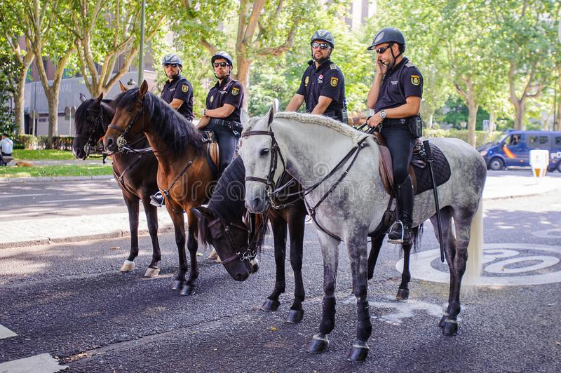 Celebration of the coronation of the New King of Spain Felipe IV. MADRID, SPAIN - JUN 19, 2014: Unidentified Spanish policemen look for the orden in the centre royalty free stock image