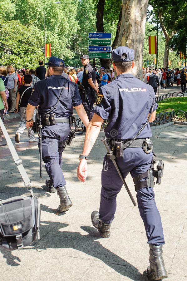 Celebration of the coronation of the New King of Spain Felipe IV. MADRID, SPAIN - JUN 19, 2014: Unidentified Spanish policemen look for the orden in the centre stock photo