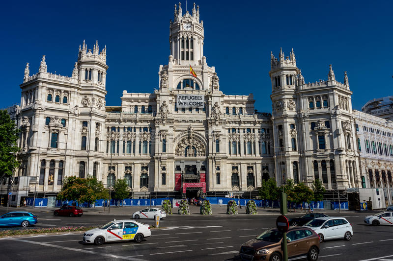 Madrid, Spain - June 17 : The Madrid city hall on June 17, 2017. A welcome refugees banner is displayed on the city hall. royalty free stock photos