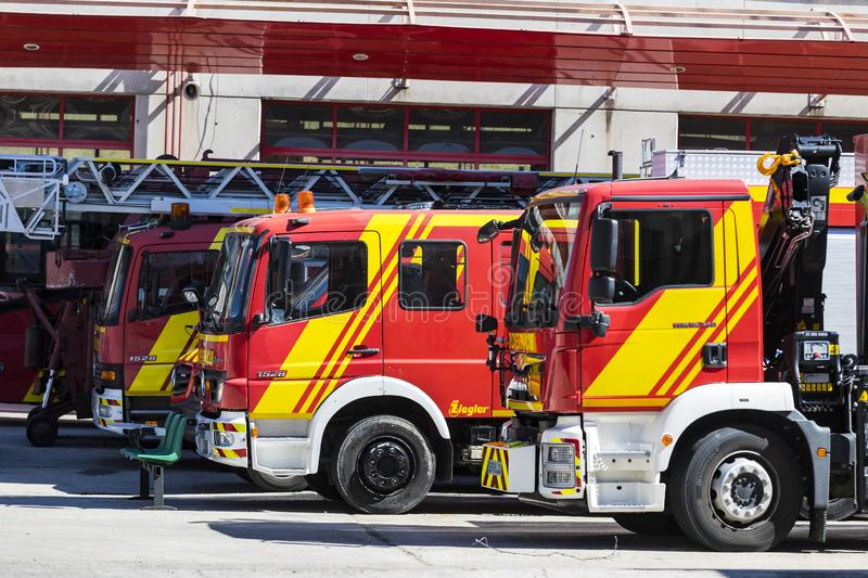 Garage of cars and equipment of the city fire department. MADRID, SPAIN - 26 MARCH, 2018: Garage of cars and equipment of the city fire department royalty free stock photos