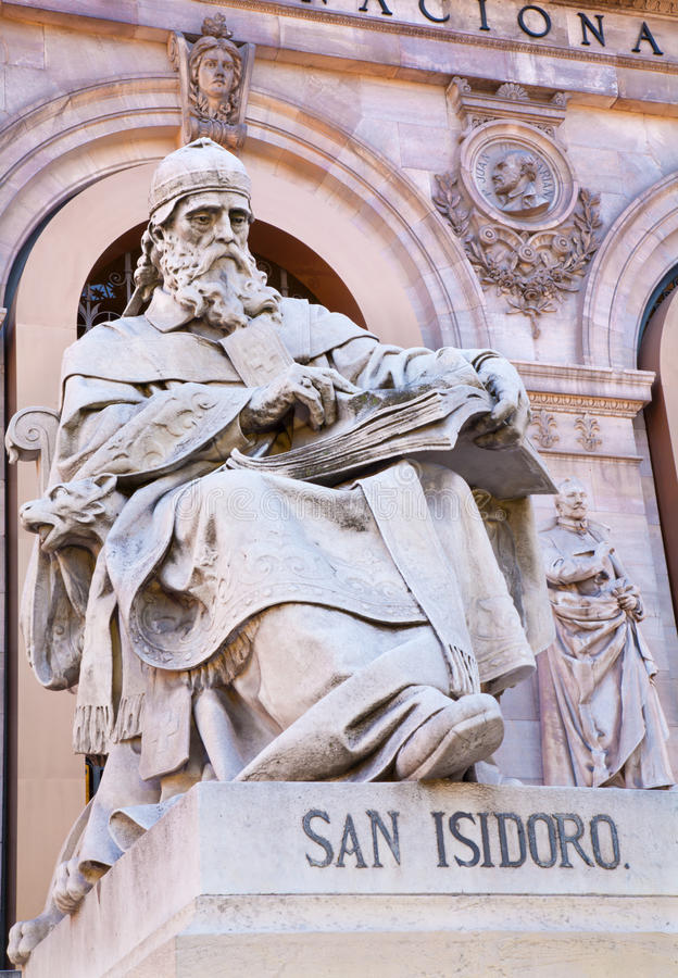 MADRID, SPAIN - MARCH 11, 2013:: Saint Isidore of Seville from Portal of National Archaeological Museum of Spain royalty free stock images
