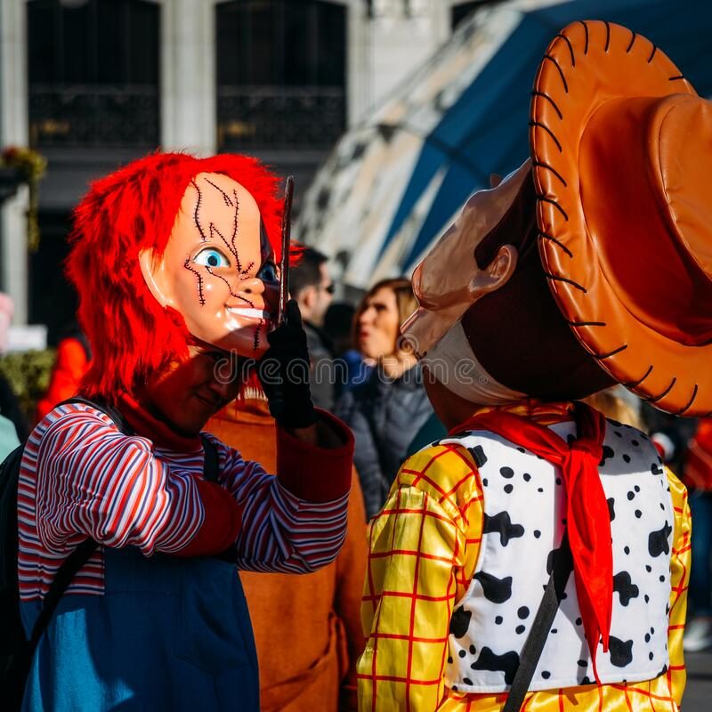Woman dresssed up as Chucky in Puerta del Sol, Madrid, Spain. Madrid, Spain - March 7, 2020: Woman dresssed up as Chucky in Puerta del Sol, Madrid, Spain stock images