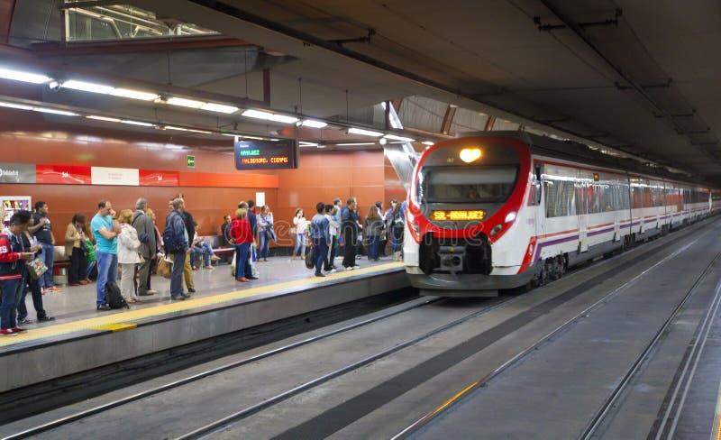 MADRID, SPAIN - MAY 28, 2014: People waiting train on platform, underground station Madrid. MADRID, SPAIN - MAY 28, 2014: underground station Madrid stock photography