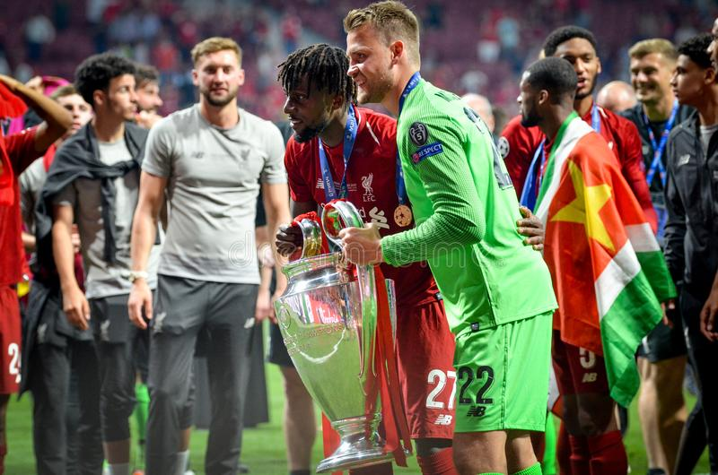 Madrid, Spain - 01 MAY 2019: Simon Mignolet and Divock Origi celebrate their winning of the UEFA Champions League 2019 after the. Final game against Tottenham stock photos