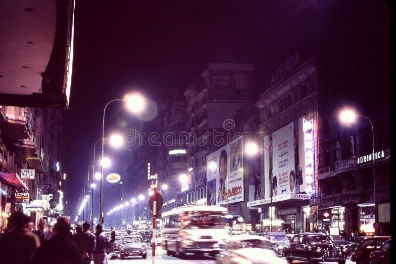 MADRID, SPAIN: NIGHT SHOT OF `LA AVENIDA DE JOSE ANTONIO` a. k. a. `LA GRAN VIA, ` MADRID`S MAIN STREET IN DECEMBER, 1966 royalty free stock photo