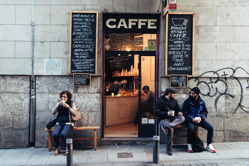 People drinking coffee outside hipster cafe in Malasana distric stock photos