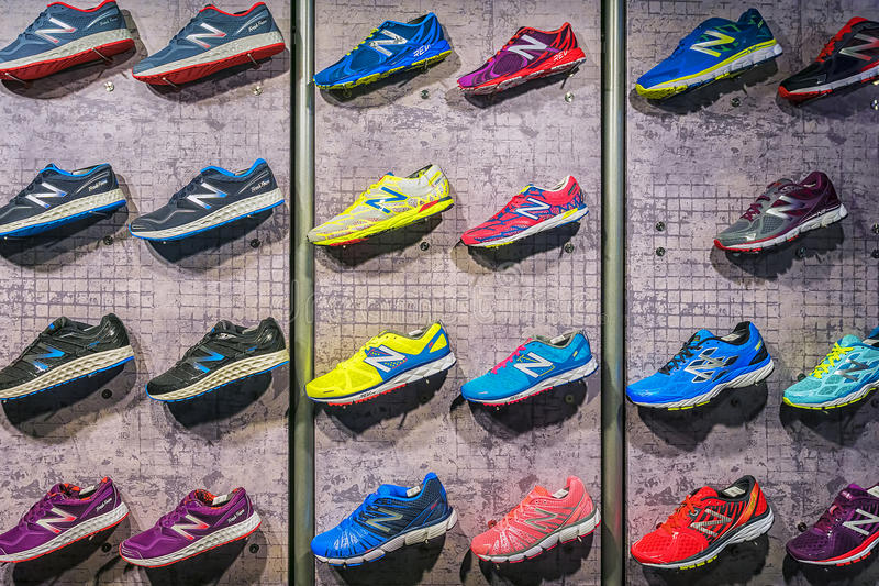 MADRID, SPAIN - SEPTEMBER 9: New Balance athletic shoes on a sports shop counter in Madrid on September 9 2015. New Balance -. American manufacturer of stock photography