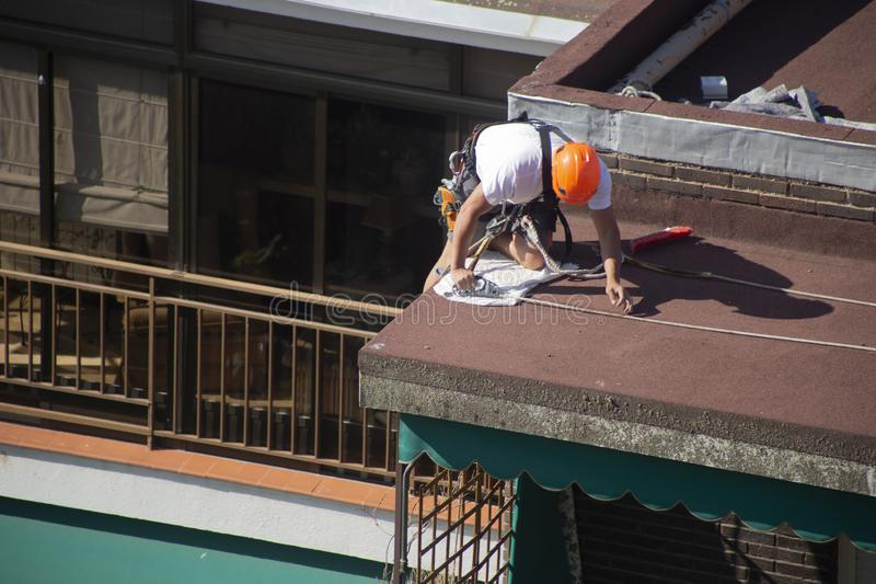 Madrid, Spain - September, 04, 2019: work at height. Worker with harness for dangerous work. A worker prepares with the helmet and harness to work at height from stock photo