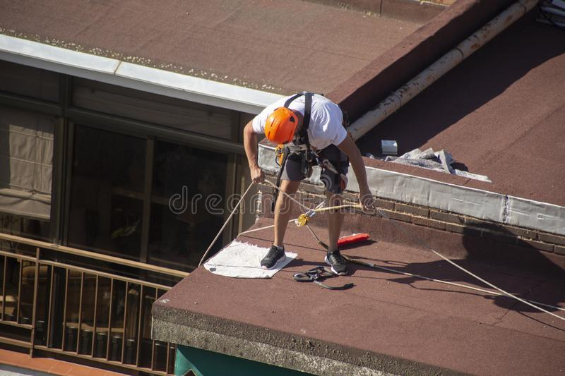 Madrid, Spain - September, 04, 2019: work at height. Worker with harness for dangerous work. A worker prepares with the helmet and harness to work at height from royalty free stock photos