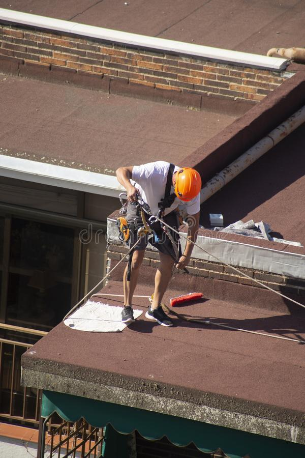 Madrid, Spain - September, 04, 2019: work at height. Worker with harness for dangerous work. A worker prepares with the helmet and harness to work at height from stock image