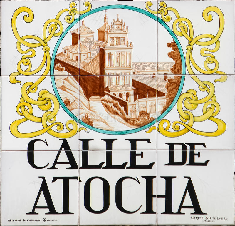 Madrid street sign. Closeup of the street sign. Street signs in Madrid are hand-painted ceramic tiles typically composed within 9 or 12 tiles. They depict the royalty free stock image